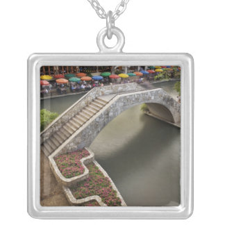 Outdoor cafe along River Walk and bridge over Silver Plated Necklace