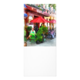 Outdoor Cafe With Red Umbrellas Rack Card