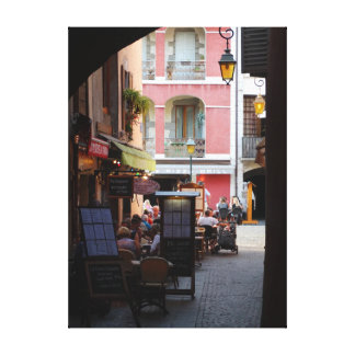 Outdoor Cafés, Restaurants in Quaint French Town Canvas Print