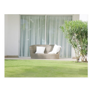 Outdoor sofa, expressing a relaxing place postcard