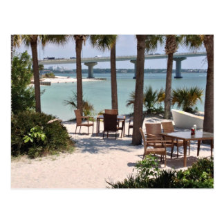 Outdoor tables and chairs at resort postcard