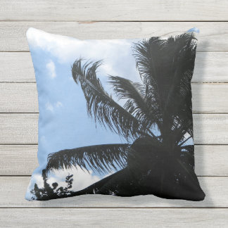 outdoor throw pillow with palm tree