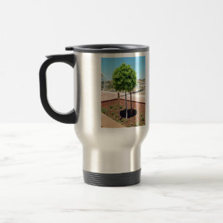 Outdoor topiary in brick planter coffee mug