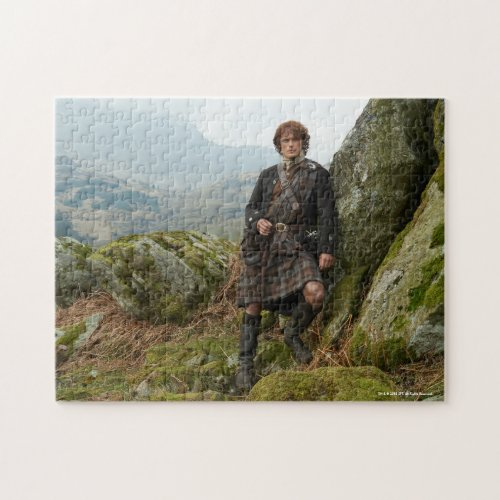 Outlander  Jamie Fraser _ Leaning On Rock Jigsaw Puzzle
