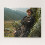 """Outlander   Reclining Jamie Fraser Photograph Jigsaw Puzzle<br><div class=""""desc"""">Photographic gallery image of James Alexander Malcolm MacKenzie Fraser,  leaning against a Highland crag,  from Season 1 of the Outlander television series</div>"""