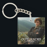 "Outlander | Reclining Jamie Fraser Photograph Keychain<br><div class=""desc"">Photographic gallery image of James Alexander Malcolm MacKenzie Fraser,  leaning against a Highland crag,  from Season 1 of the Outlander television series</div>"