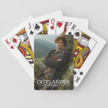 "Outlander | Reclining Jamie Fraser Photograph Playing Cards<br><div class=""desc"">Photographic gallery image of James Alexander Malcolm MacKenzie Fraser,  leaning against a Highland crag,  from Season 1 of the Outlander television series</div>"