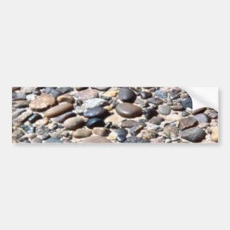 Oval washed river rocks in grey sand car bumper sticker