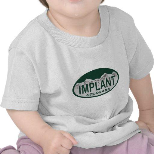 Óvalo de la licencia del implante camiseta