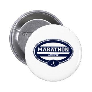 Óvalo del maratón para los atletas y los espectado pin