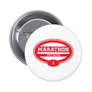 Óvalo del maratón para los atletas y los espectado pins