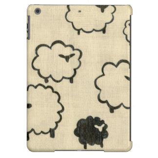 Ovejas blancas y negras en el fondo poner crema funda para iPad air