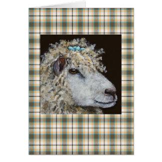 ovejas con la tarjeta de la jerarquía en la tela e