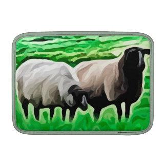 ovejas de cabeza negra que pastan fundas MacBook