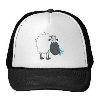 ovejas divertidas del dibujo animado con la flor gorro