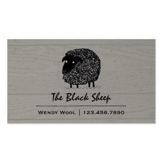 Ovejas negras en el fondo de madera del estilo tarjetas de visita