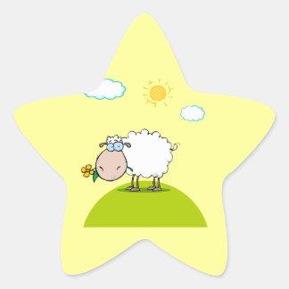 ovejas tontas en una colina con una flor pegatina en forma de estrella