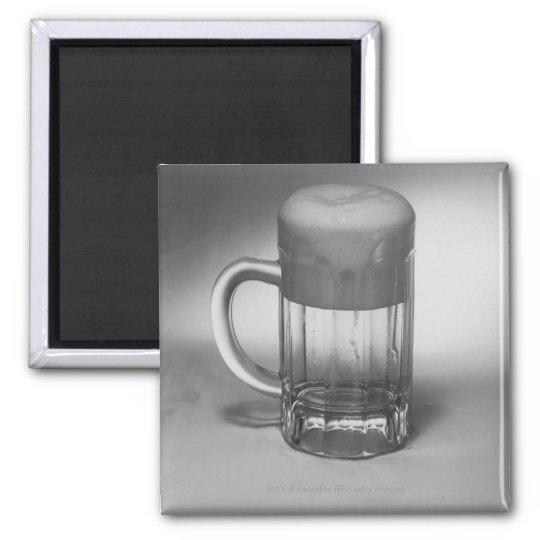 Overflowing beer glass magnet