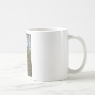 Overgrown branches with green moss coffee mug
