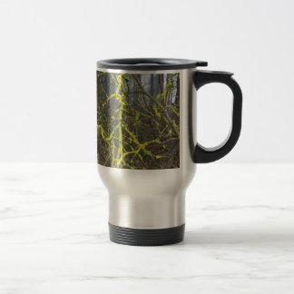 Overgrown branches with green moss travel mug