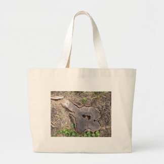 Overhead view of an old stump of cut tree large tote bag
