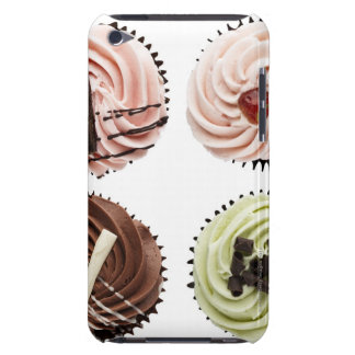 Overhead view of four cup cakes on white iPod touch cover