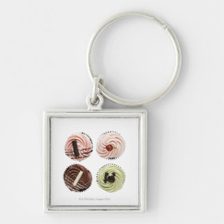 Overhead view of four cup cakes on white keychain
