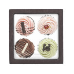 Overhead view of four cup cakes on white premium jewelry box