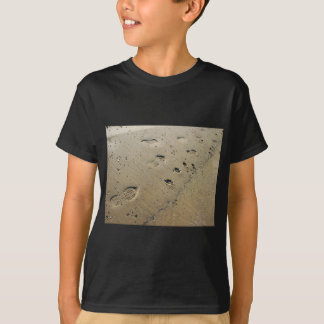 Overhead view on the wet sand at the beach with fo T-Shirt