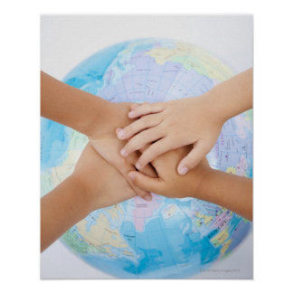 Overlapping hands and a globe poster