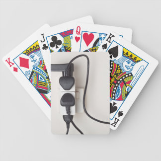 Overloaded ac power wall socket bicycle playing cards