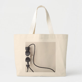 Overloaded ac power wall socket large tote bag