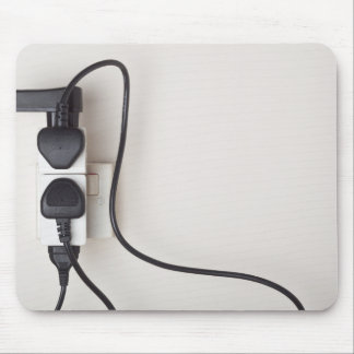Overloaded ac power wall socket mouse pad
