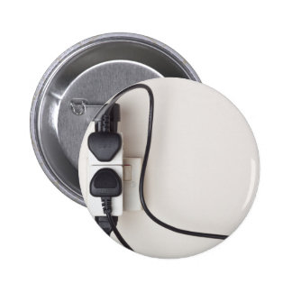 Overloaded ac power wall socket pinback button