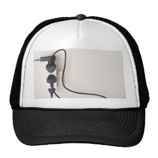 Overloaded ac power wall socket trucker hat
