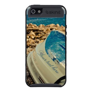 Overturned Boat on Sea shore skinit iPhone 5 case