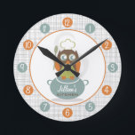 """Owl Chef Personalized Kitchen Clock<br><div class=""""desc"""">A clock featuring an illustration of an owl wearing a chef&#39;s hat.  Owl is holding a spoon and is perched on a blue pot. Personalize with your name about illustration.  Clock features white numbers on blue and orange dots.</div>"""