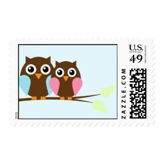 Owl couple on a branch postage
