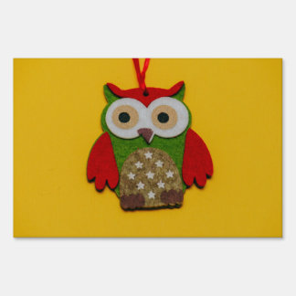 Owl decoration on a yellow background sign