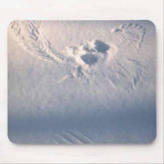 Owl feather imprint in the snow mouse pad