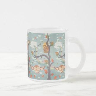 Owl flying near a Tree Coffee Mug