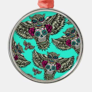 Owl holding sugar skull on mint green base. metal ornament
