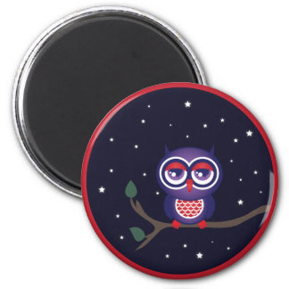 Owl perched on a branch fridge magnet