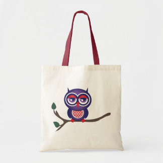 Owl perched on a branch tote bag
