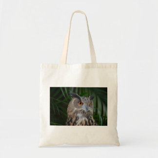 owl turning to the right head view tote bags
