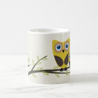 Owls couple on the tree. coffee mugs