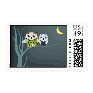 Owls couple on the tree. postage