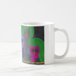 Owls on a branch coffee mug