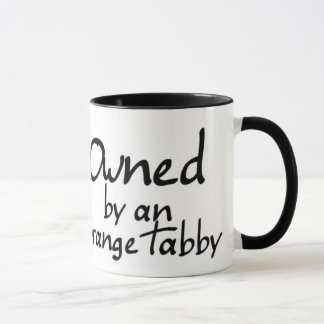 owned orange tabby mug