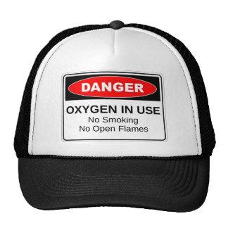 Oxígeno del peligro funcionando gorras